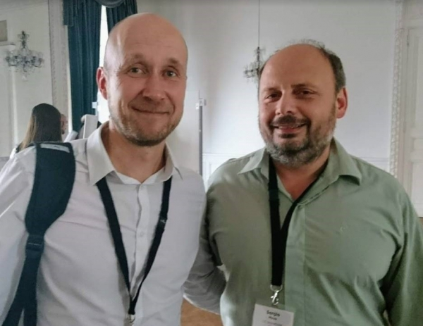 Dr. Teesalu (left) with Dr. Sergio Moya (the organizer of the workshop on self assembly and hierarchical materials in biomedicine in San Sebastián, Spain